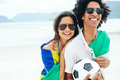 World cup soccer couple portrait of latino with brasil flag and ball for Royalty Free Stock Photography