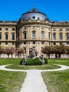 The world famous Würzburger Residenz residence of Würzburg in spring time during the cherry blossom Royalty Free Stock Photo