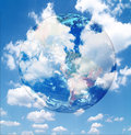 World globe with clouds Stock Images