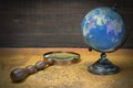World Globe  And Magnifier On The Old Map Royalty Free Stock Photo
