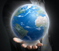 World in a hand close up d render Stock Photography