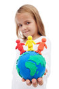 A world of harmony concept with little girl holding earth globe and people made clay Stock Photography