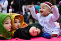 World hijab day in manila a boy plays around with mannequin heads wearing hijabs veil during the observance of at the quezon Stock Photo