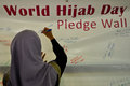 World hijab day in manila a hijabi woman wearing a veil signs her pledge for unity during the observance of at the quezon memorial Royalty Free Stock Images