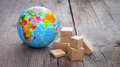World import and export miniature globe boxes on wooden background Stock Photography