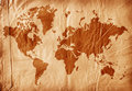 World map on aged paper Royalty Free Stock Photo