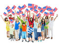World people holding american flag cheerful multi ethnic group of standing with their arms raised Stock Image