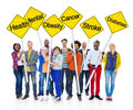 World people holding yellow sign poles with health related words Stock Image