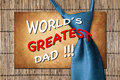World s greatest dad tie over bamboo and stone and the words Royalty Free Stock Photos