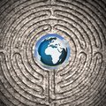 The world seen through a labyrinth carved in stone - concept image Royalty Free Stock Photo