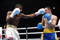 World series of boxing ukraine otamans vs cuba domadores kyiv february hasanboy dusmatov and joahnys oscar argilagos perez in the Royalty Free Stock Photography