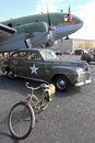 World war ii military display curtiss wright c commando aircraft a bicycle and a chrysler staff car on at the warbirds over monroe Stock Photos