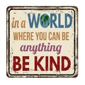 In a world where you can be anything be kind vintage rusty metal sign Royalty Free Stock Photo