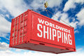 World Wide Shipping - Red Hanging Cargo Container. Royalty Free Stock Photo