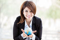 The world is in your hands beautiful hispanic business woman holding a small globe her and smiling Stock Photography