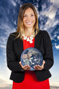 World at your hands. Woman smiling with earth in hands Royalty Free Stock Photo