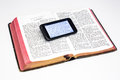 Worn Bible and Smartphone - Ezekiel Royalty Free Stock Photo
