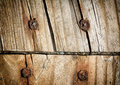 Worn boards with screws detailed close up of weathered deck rusted a great texture image for a background or overlay Royalty Free Stock Photos