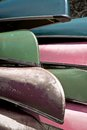 Worn canoes vertical image of the tips of a group of well blue green pink and brown Stock Image