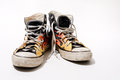 Worn converse all star shoes isolated on white background Royalty Free Stock Photo