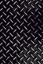 Worn diamond plate grunge rough and textured high contrast background in black and white Royalty Free Stock Image