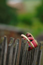 Worn kids shoes on fence hanging Royalty Free Stock Photos