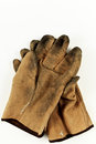 Worn leather work gloves closeup of a pair of isolated on a white background made in america Stock Photo