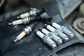 Worn and new spark plugs Royalty Free Stock Photo