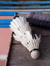 Worn out used badminton equipment on a wood table Royalty Free Stock Image