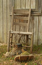 worn out work boots and chair Royalty Free Stock Photo