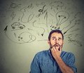 Worried anxious young man bitting his fingernails Royalty Free Stock Photo