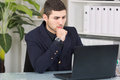 Worried business man looking at laptop Stock Photo