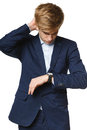 Worried business man looking at wrist watch Royalty Free Stock Photo