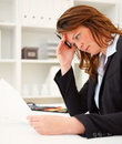 Worried business woman reading a document Stock Photo