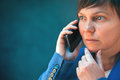 Worried businesswoman talking on mobile phone Royalty Free Stock Photo