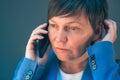 Worried businesswoman during unpleasant telephone conversation