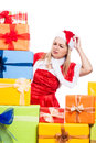 Worried christmas woman looking at presents many isolated on white background Royalty Free Stock Image