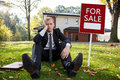 Worried estate agent real and house for sale Stock Image