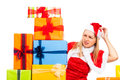 Worried female Christmas Santa with many gifts Royalty Free Stock Photography