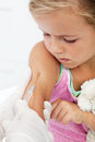 Worried little girl getting an injection Royalty Free Stock Images