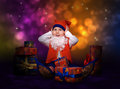 Worried little gnome with gift boxes Royalty Free Stock Image