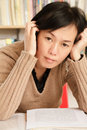 Worried mature Asian woman Royalty Free Stock Image