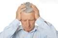 Worried mature man holding his head with hands Stock Photos