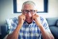 Worried senior man sitting in living room Royalty Free Stock Photo
