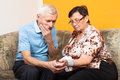 Worried seniors measuring blood pressure Royalty Free Stock Photo