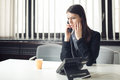 Worried stressed depressed office worker business woman receiving bad news emergency phone call at work.Looking confused Royalty Free Stock Photo