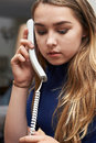 Worried Teenage Girl Making Call On Phone Royalty Free Stock Photo