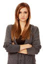 Worried teenage woman with folded arms Royalty Free Stock Photo