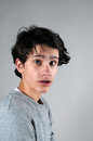 Worried teenager boy with disheveled hair Stock Photography