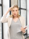 Worried woman with documents indoor picture of Royalty Free Stock Photography